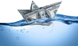 100 dollar bill shaped like a ship in water